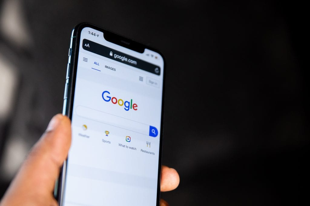 Google Scams: How to stay safe using Google Ads - Image of mobile phone